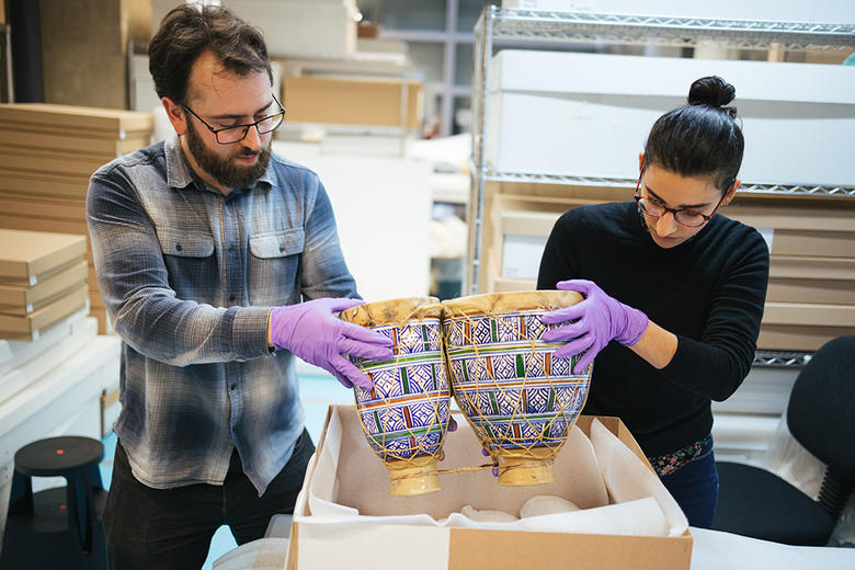 Collections Move team moving objects in the Pitt Rivers Museum collection