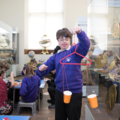 Keystage 3 student making a balance scale from cups at the History of Science Museum. Image Oxford University Gardens, Libraries & Museums; credit Claire Williams