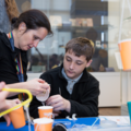 7.	Primary Learning Officer Helen Pooley assisting a student making a balance scale at the History of Science Museum. Image Oxford University Gardens, Libraries & Museums; credit Claire Williams
