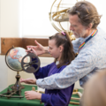 9.Secondary Learning Officer Chris Parkin showing a Keystage 3 student how to use a mariner's astrolabe at the History of Science Museum. Image Oxford University Gardens, Libraries & Museums; credit Claire Williams.