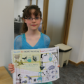 Child showing her logbook at Arts Award pilot activity session