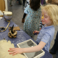 Child touching bear paw at Arts Award pilot activity session