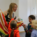 Education officer showing children Chinese dragon at Arts Award pilot activity session