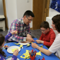 Family doing craft activity together at Arts Award pilot activity session