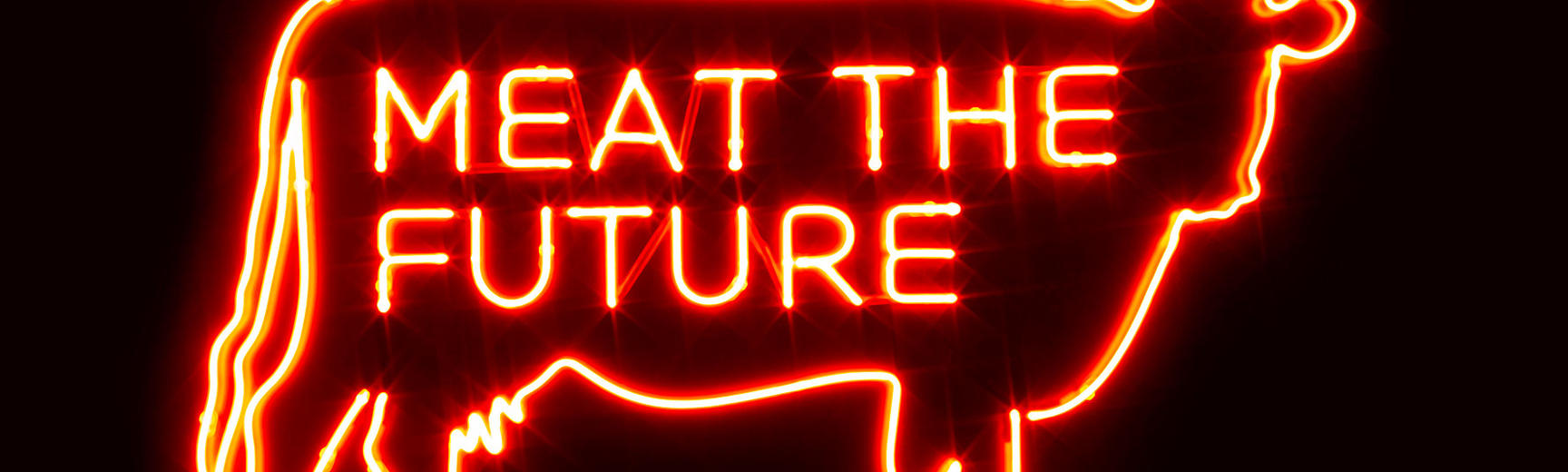 Neon sign of cow with Meat the Future