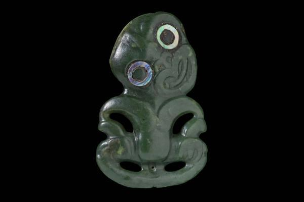 Breast ornament, hei tiki, of nephrite, from New Zealand.