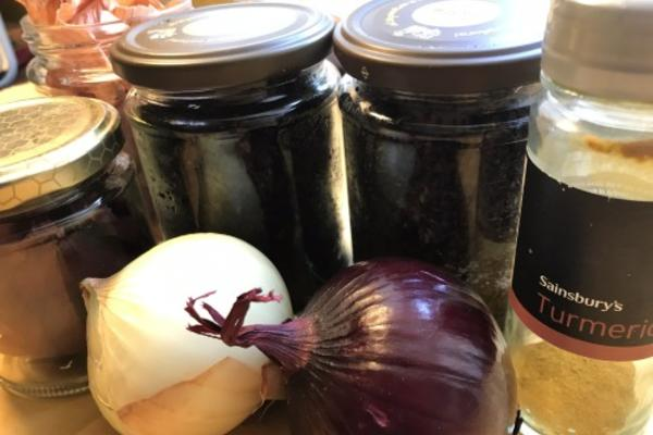 Turmeric, two onions, and several jars