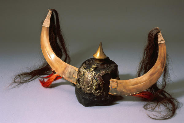 Dance hat made from old German military helmet, with horns and hair attached at Pitt Rivers Museum