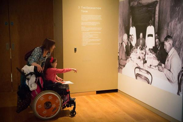 A wheelchair user visiting an exhibition at the Ashmolean