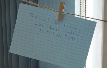 'social prescribing' written on a piece of paper, hanging to a washing line